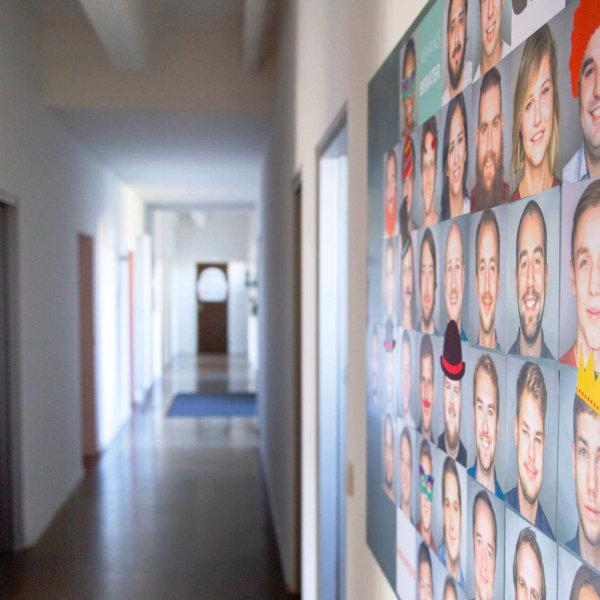 office corridor with employee photos